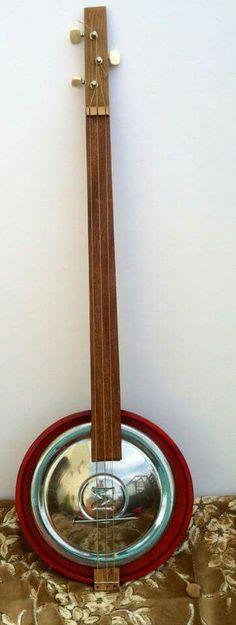 Morris hubcap guitar