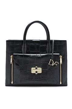 By day, she is structured and sleek. By night, she comes unzipped. The DVF Secret Agent is the ultimate day-to-night bag: a streamlined tote that conceals a detachable, zip off go-anywhere clutch. Lightweight and customizable, she is always ready at a moment's notice, the ultimate accomplice in everything you do. The larger of two totes, this Secret Agent features a clutch that can be carried alone, and replaced with clutches in different colors and fabrications. Also features a magnetic…