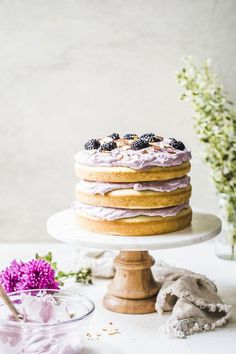 This lavender almond cake is made with almond extract and topped with a simple blackberry lavender mascarpone whipped cream icing. Lovely light, airy cake styling with purple pops Delicious Cake Recipes, Yummy Cakes, Dessert Recipes, Nake Cake, Whipped Cream Icing, Lavender Cake, Culinary Lavender, Almond Cakes, Cake Ingredients