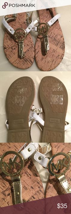 Michael Kors gold and white sandals Cute Michael Kors sandals. New no box or tag. Great way to introduce Michael Kors to your child Michael Kors Shoes Sandals