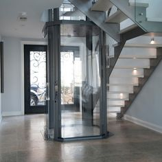 The Visi 48 Octagonal Glass Home Elevator by Nationwide Lifts is surely a showcase center piece that also provides quick and easy means to access all four levels of this upscale, metro style home.