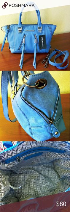 49✂Steve Madden Satchel in Baby Blue ✨NWT✨  ⏩Made from pebbled faux leather, this satchel features deep, luxuriously rich baby blue color with sleek slate gray hardware ⏩Sturdy dual handles ⏩Removable,adjustable shoulder strap with leather & chain combination ⏩Top zipper closure with faux leather tassels ⏩Exterior➖ 2 asymmetrical zip pocket,  side zippers to convert size up/down ⏩Interior➖1 zip pocket, 2 slip pockets   ⏩Great looking bag, ample room with durable & easy care material…