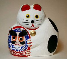 JA hariko maneki neko with a Matsukawa daruma. This piece is from Sendai, which is the largest city in the Tohoku region of northern Honshu.apanese Dolls