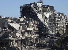 PHOTO: Homs, Syria, during the first evacuation 12 February. Paris Skyline, New York Skyline, Syrian Civil War, Rebel, City, World, February, Syria, People