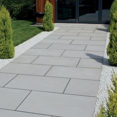 Natural Paving smooth sandstone with a sawn and sandblasted finish for slip resistant qualities. The surface and sides of this Paving are sawn for contemporary style garden Side Walkway, Backyard Walkway, Backyard Patio Designs, Backyard Landscaping, Garden Slabs, Patio Slabs, Garden Paving, Modern Driveway, Stone Driveway