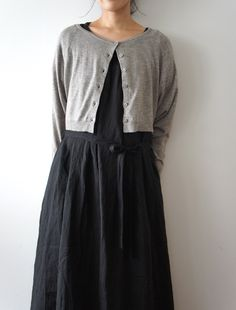 Ohh....unique oddments....tiny shrunken sweater in gray and charcoal black long dress, too cool. Love this odd combo!