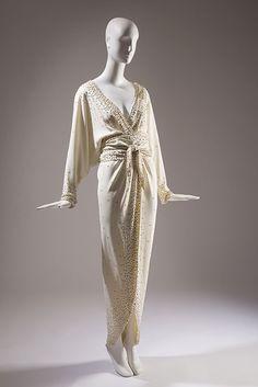 Halston Off-white evening ensemble Silk crepe, metallic grommets, 1982, New York, 91.104.1, gift of Toni Ausnit
