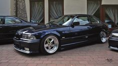 Black BMW e36 coupe on cult classic Gotti G1001 wheels