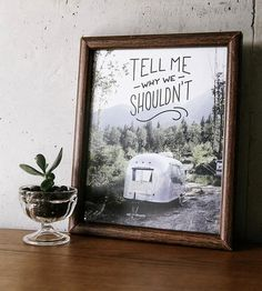 This photo print features sassy text and a shiny aluminum airstream sitting on the side of a mountain. So tell us again why we shouldn't call in sick and take an extended camping trip in a little forest clearing like this?