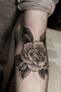 I love black and white rose tattoos