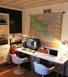 """Mark & Charmaine's """"Sporty"""" Home Office. I love the dual desk set up, chaits and the map backdrop."""