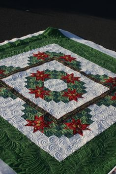 Christmas Wreath...beautifully quilted by Charisma