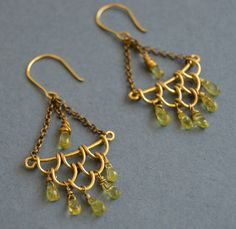 A personal favorite from my Etsy shop https://www.etsy.com/listing/522604703/peridot-antique-brass-earrigns-green
