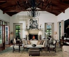 All the hallmarks of Spanish Colonial style - iron chandeliers, rustic beamed ceilings and stucco walls