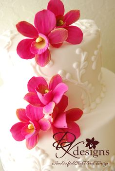 Look at these amazing clay flowers on Jen's Cakes, www.jenscakes.com, by DK Designs, www.dkdesignshawaii.com