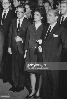 Mrs. John F. Kennedy (C) attending the funeral service for Robert F. Kennedy.
