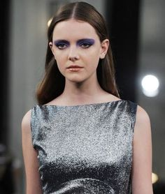 Makeup artist Charlotte Tilbury mixed three shades of purple shadow together (two violets and a pale lilac) and applied the combination all over the models' lids, blending the color all the way up to the brows backstage at Victoria Beckham.