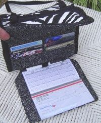The Sidekick pattern has TWELVE slots for credit & loyalty cards and a pull-down check register section.  :)