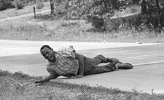 Civil rights activist James Meredith grimaces in pain as he pulls himself across Highway 51 after being shot in Hernando, Miss., June 6, 1966. Meredith was leading the March Against Fear to encourage African-Americans to exercise their voting rights when he was shot. He completed the march from Memphis, Tenn., to Jackson, Miss., after treatment of his wounds. AP PHOTO / JACK THORNELL