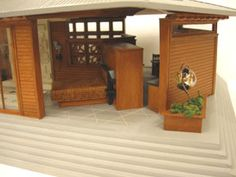A scale house in the Frank Lloyd Wright style by Artisan Carol Silberman. Victorian Dollhouse, Miniature Dollhouse, Miniature Houses, Corner Table, Cozy Corner, Fairy Houses, Doll Houses, Frank Lloyd Wright Style, Dollhouse Interiors