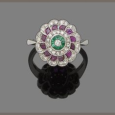 An emerald, ruby and diamond target ring
