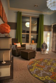 mod decor.  I love these drapes, and the orange accents.  But J would protest, lol.