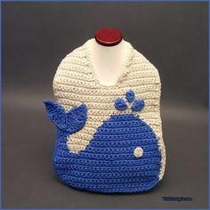 Save those cute outfits and protect the front of your baby's clothing with The Blue Whale Baby Bib! This cotton bib uses a graphing technique to create this fun aquatic themed infant accessor…