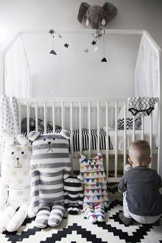 Stunning Scandinavian inspired nursery featured Stokke Home Crib in White