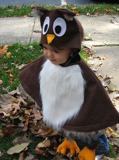 A four piece owl costume for children 1 to 3 years of age. This costume is constructed from fleece with a soft faux fur belly and natural