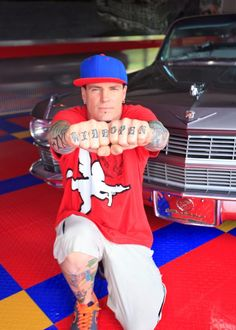 """Psst! DIY Celebs Want to Show You Their Tattoos: """"The tattoo on my knuckles is a motocross term meaning, 'throttle wide open.' Like in car racing, the expression they say is, 'pedal to the metal.' You have to pin it to win it!""""  From DIYnetwork.com"""