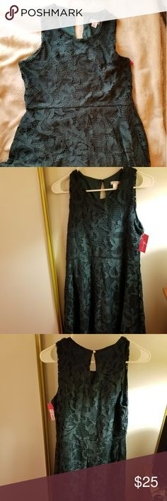 Green lace dress I got this for Christmas, but it's not my size. Size: M blueish green but mostly green. Xhilaration Dresses Mini