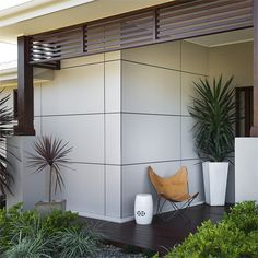 Scyon Matrix is used here contrasted with warm timber to create a Balinese-villa resort-style entranceway which turns heads in the neighbourhood. House Design, Exterior Design, Luxury Homes, New Home Construction, House Cladding, House Entrance, Exterior Cladding, External Cladding, House Exterior