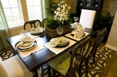 Setting the dining room table gives a potential buyer a sense of being, the can see their family and friends enjoying a diner or party in the space and are more likely to make an offer on your home.