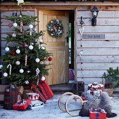 Festive entrance with outdoor Christmas tree