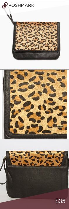 """NWT Obey leopard/black tablet or large clutch Still in plastic, Shepard Fairey Obey clothing line, from the Dark Shadows series. Limited and rare! Zip top tablet case with leopard printed flap Zipper pull is a self PU wrist strap Interior is padded for protection. Fits up to a 7 1/2"""" W x 9 1/2"""" L SHELL: 100% PU; FLAP: 100% Polyester; LINING: 100% Polyester Obey Bags Clutches & Wristlets"""