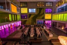 The architecture at this venue is just begging to be uplit, which is an effective way to celebrate the architecture of a building, inside and out. SFMOMA's Directors Circle Dinner at the AirBNB Headquarters in San Francisco with Blueprint Studios. Photo by Show Ready Photography. Lighting Design by Got Light.