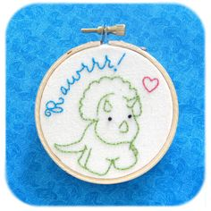 triceratops dinosaur embroidery hoop art 3 inch wall hanging hand stitched cotton