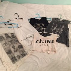 Brandy Melville Graphic Muscle Tanks All in good condition and from Brandy except for the Celine tank. $12 each, $50 for all Brandy Melville Tops Muscle Tees