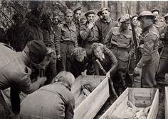 Soltau, Germany, Local women are being forced by British soldiers to bury the dead.