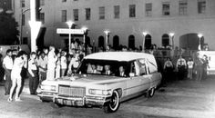 "The hearse carrying Elvis' body leaving ""Baptist Memorial Hospital""..."