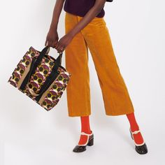 Browse our collection of designer accessories by Orla Kiely online now at the Kilkenny Shop. Irish & worldwide shipping available. Orla Kiely Handbags, Irish Pottery, Cute Pixie Cuts, Irish Art, Shades Of Purple, Flower Power, Sunnies, 1960s, Champagne