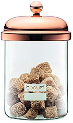 Store your food in style with this glass food jar from Bodum's premium Copper collection. With a beautiful design that celebrates the heritage and craftsmanship of Bodum's iconic French press design, this jar is perfect for elevating any occasion. Copper Kitchen Accessories, Copper Kitchen Utensils, Food Storage Containers, Jar Storage, Coffee Industry, Kitchen Canister Sets, Sugar Jar, Food Jar, Colors