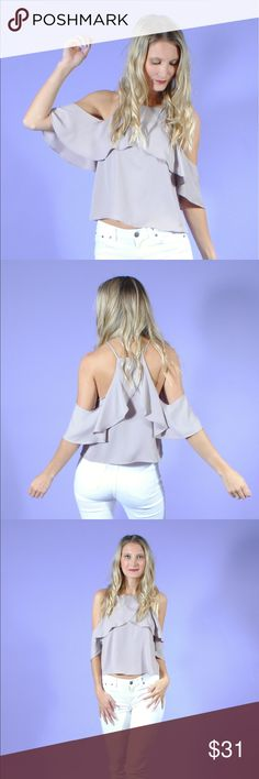 Taupe Cold Shoulder Ruffle Top This top does double duty in an understated, classic way for this season's biggest trends: cold shoulders and ruffles! Feel your best in this flattering top made of silky soft material. Pair with your favorite pair of white jeans and a colorful heel!  size + fit: Model is 5ft 8in and wearing a size small. Tops Blouses