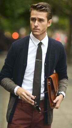 The cardigan's unique color combo meshes well with pants and tie color. Leather portfolio is a good touch to the overall look.