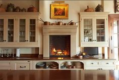 Really!  Why have I not thought of a fire place in the kitchen on top of the counter!  Imagine coming home to this sweet little set-up.