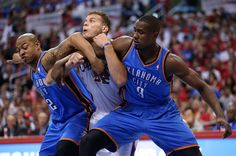 Blake Griffin of the Los Angeles Clippers battles for postion under the boards with Serge Ibaka and Caron Butler of the Oklahoma City Thunder in Game Four of the Western Conference Semifinals during the 2014 NBA Playoffs at Staples Center on May 11, 2014 in Los Angeles, California. (Photo by Stephen Dunn/Getty Images)