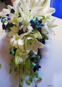 White and green with some blue cascading bouquet