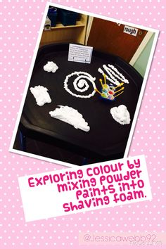 Exploring colour mixing by mixing powder paints into shaving foam. EYFS