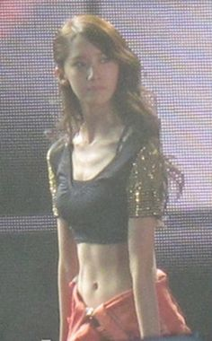 Girls' Generation member YoonA's abs are drawing some new attention.    The above photo surfaced on an online community site on February 14th with the title, 'YoonA at a concert in Thailand… looks of a goddess and abs too?' #allkpop #kpop #SNSD