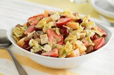 Chilled Creamy Poppyseed Pasta and Fruit Salad recipe - A perfect addition to any meal, this colorful pasta salad, featuring fresh fruits and creamy poppyseed dressing, is sure to be a hit with the home crowd.